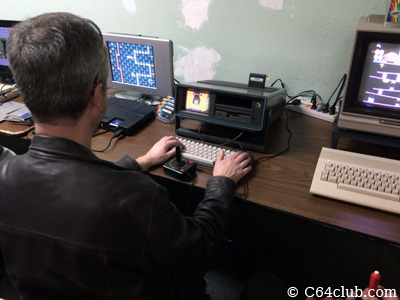 Clay Cowgill playing games SX-64 - Commodore Computer Club