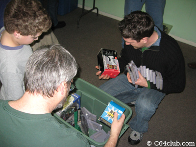 Members getting some games from the free bin - Commodore Computer Club