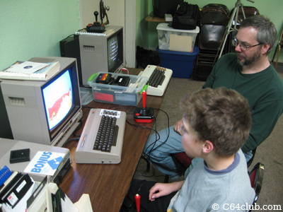 Tom and his son Ian playing Artillery Duel on the C64 - Commodore Computer Club