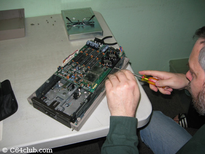 Tommy working on his 1541 disk drive - Commodore Computer Club