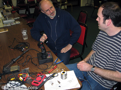 Michael learning about video cables from Dan - Commodore Computer Club