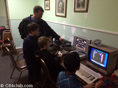 Michael with kids playing C64 games - Commodore Computer Club