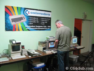 Commodore Computer Club banner above retro Commodore computers