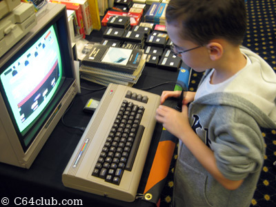 Kids playing games on Commodore computers